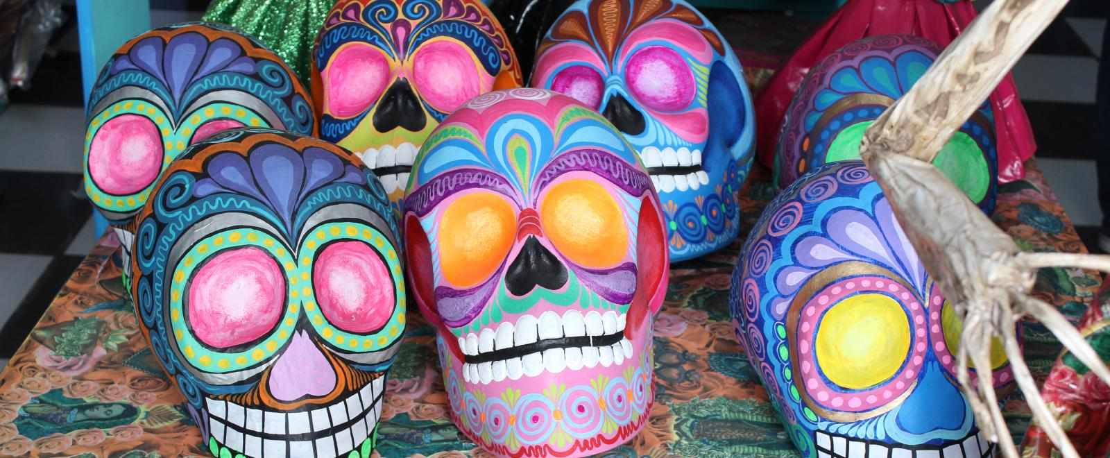 A sugar skull hand painted and on sale at a market in Mexico.